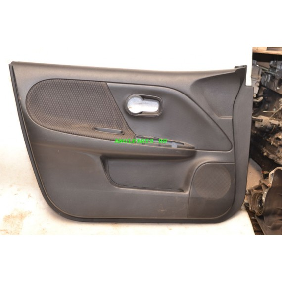 Купить Обшивка двери передней левой Nissan Note 809239U000 в Интернет-магазине