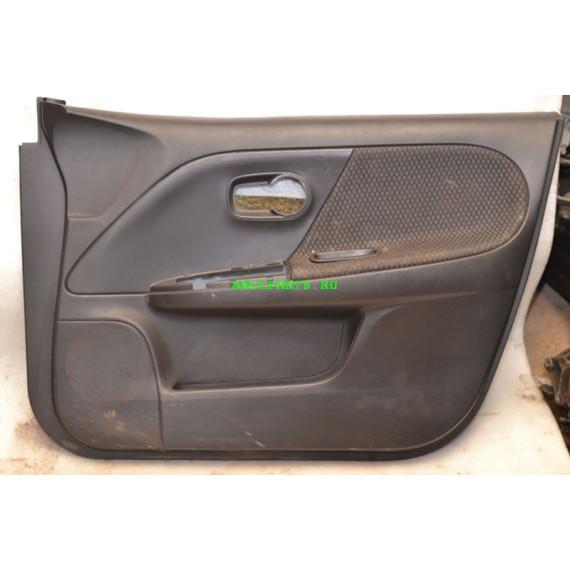 Купить Обшивка двери передней правой Nissan Note 809229U000 в Интернет-магазине